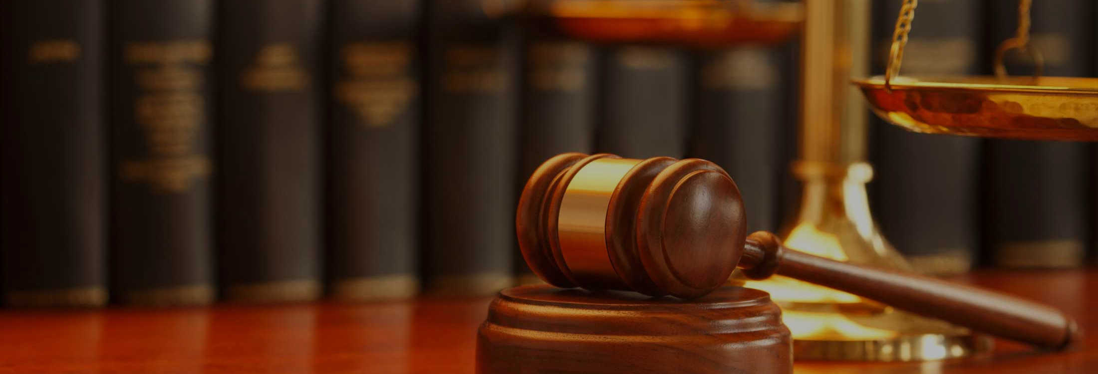 law books gavel and scales darkened the association of the federal